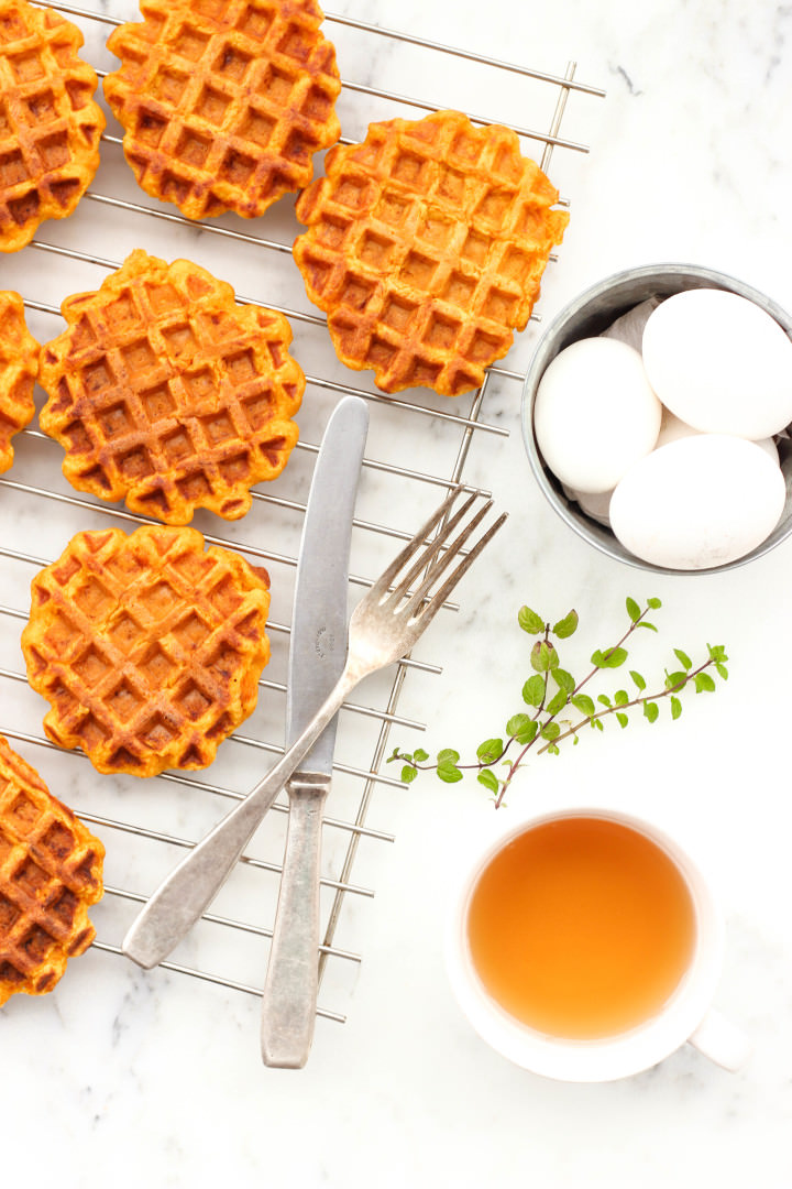 Top-down shot of pumpkin waffles on a cooling rack.