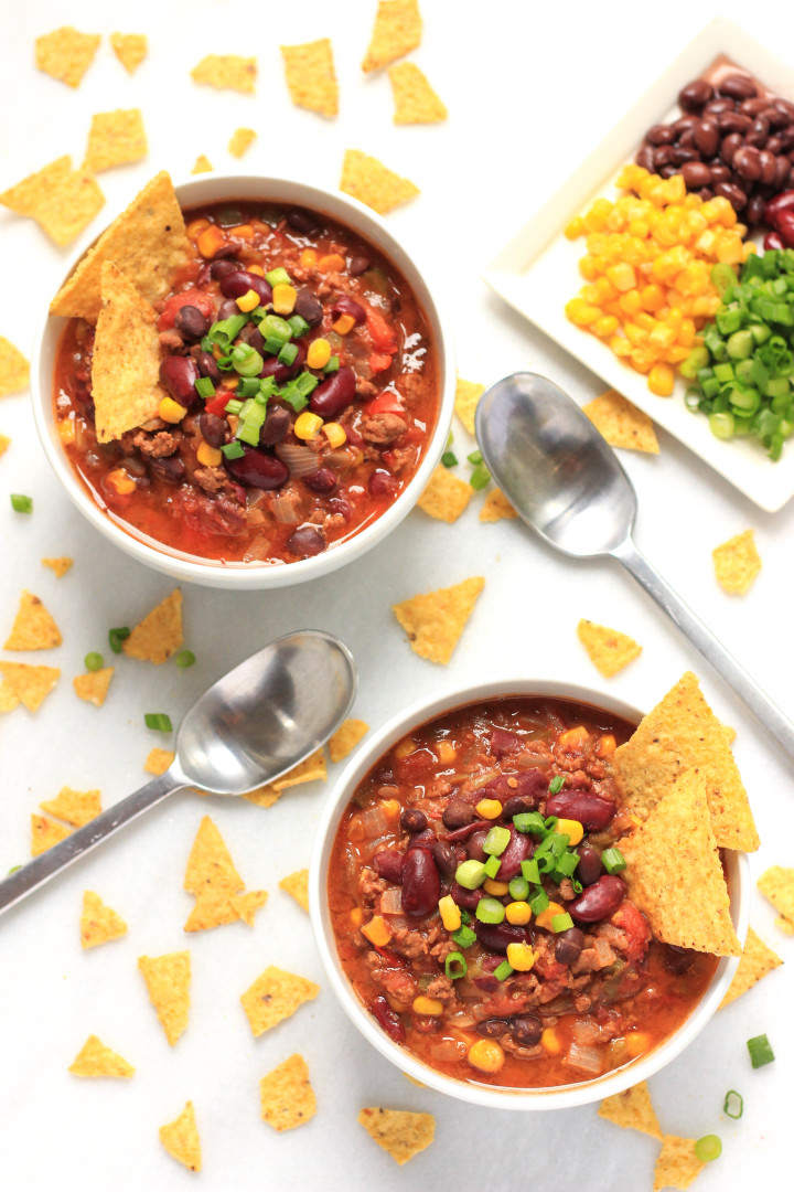 Top down shot of two bowls of chili con carne.