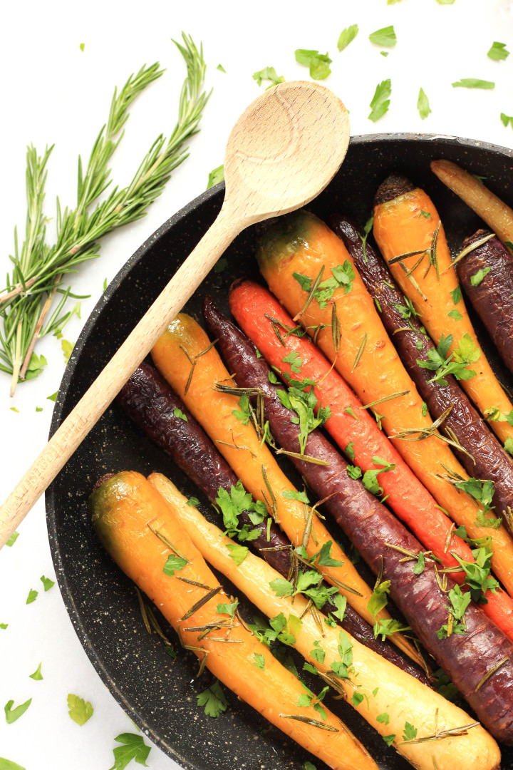 Roasted rainbow carrots in a baking dish.