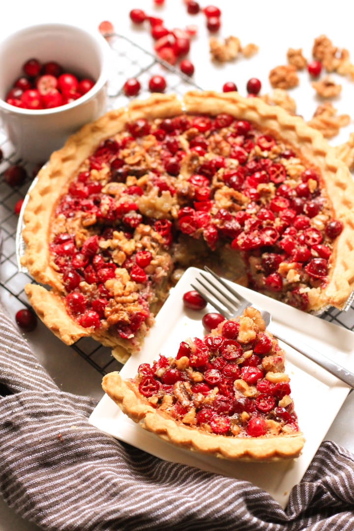 A slice of cranberry pie on a white plate.