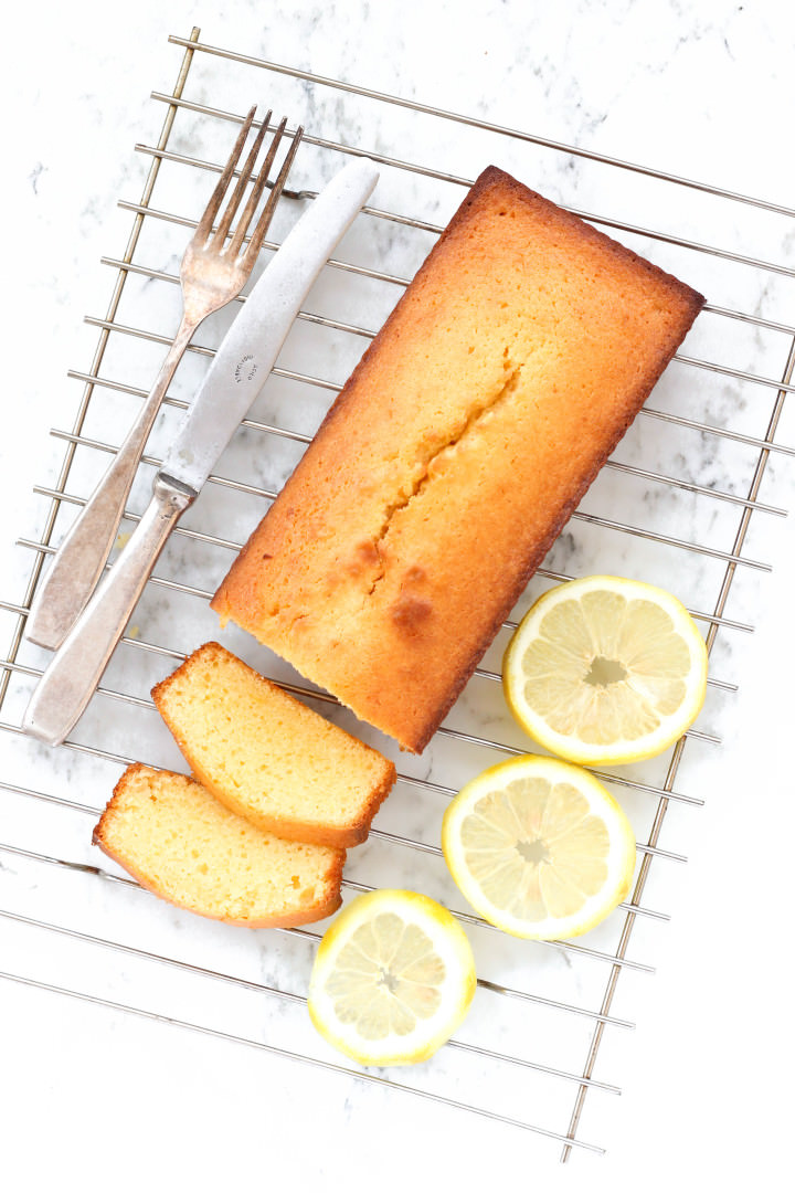 Lemon yogurt cake on a cooling rack.
