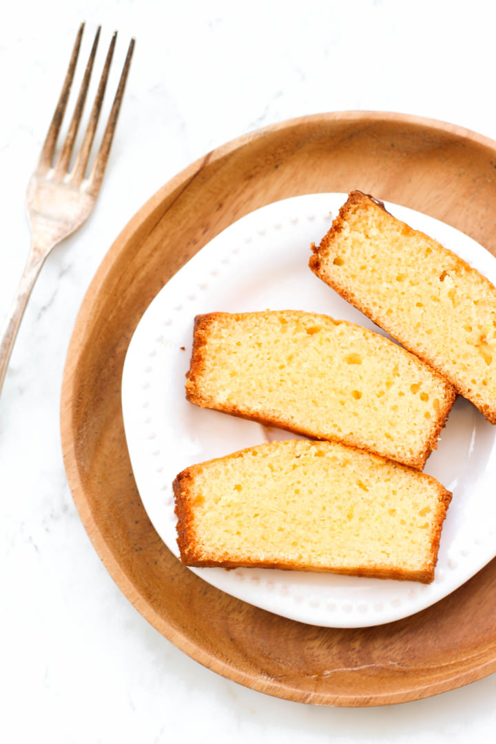 Top down shot of slices of lemon yogurt cake on a plate.