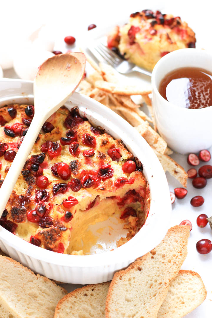 Half-eaten cranberry bread pudding.