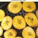 Crispy plantain chips in an air fryer basket.