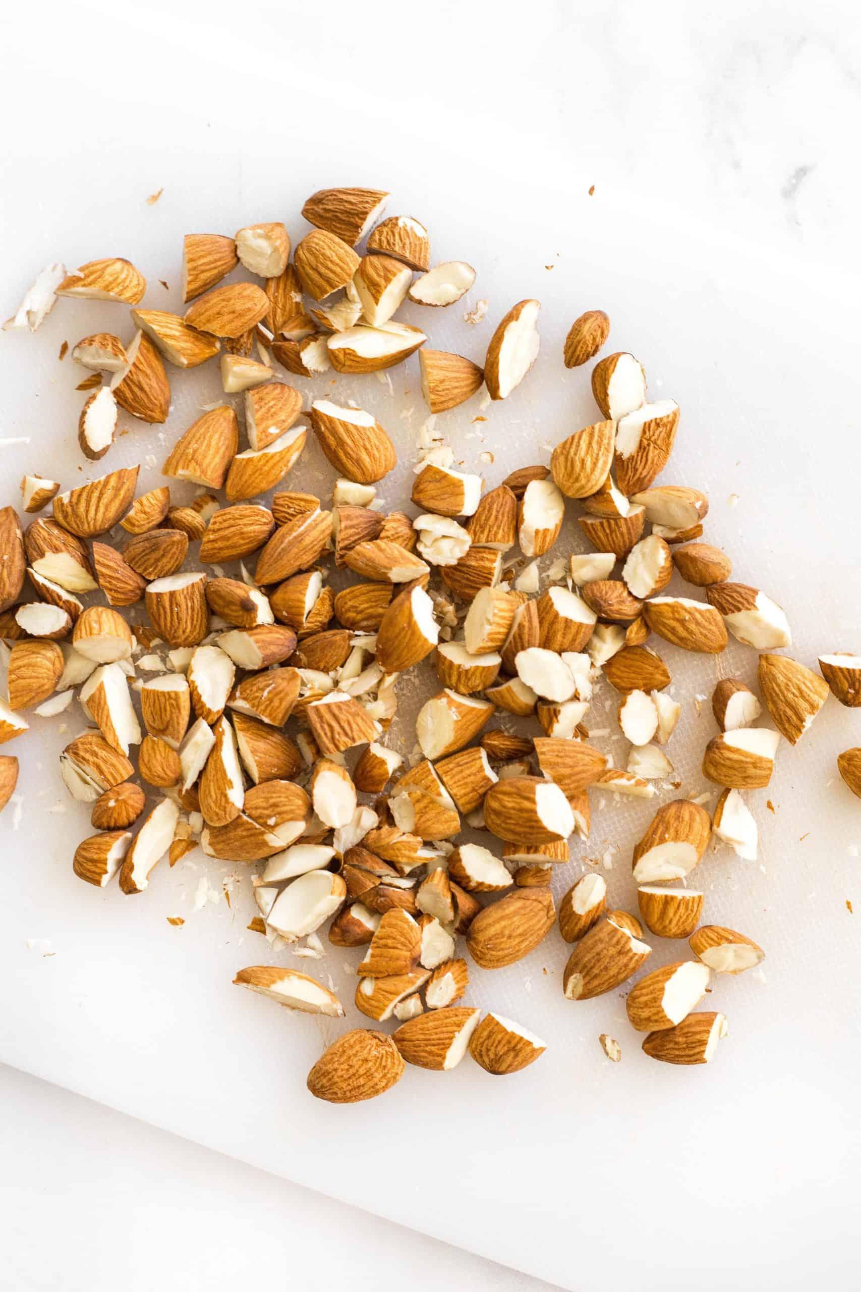 Chopped almonds on a chopping board.