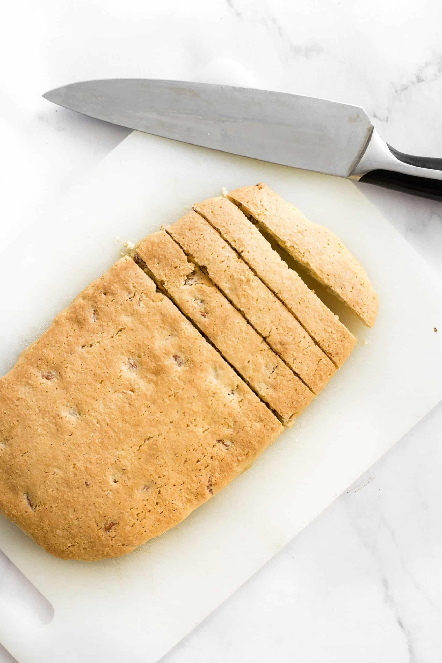 Sliced log of dough on a chopping board.