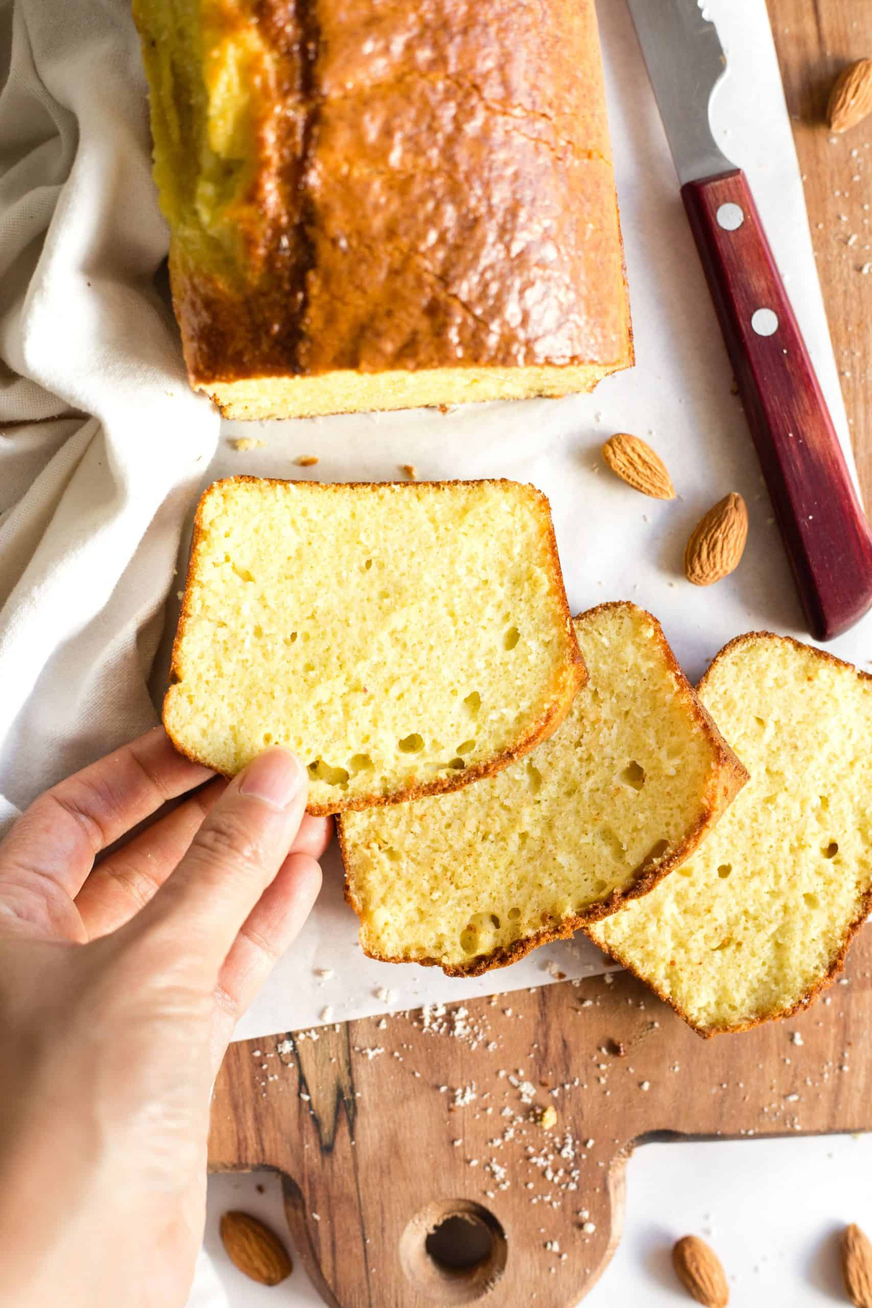 Hand holding a slice of almond bread.