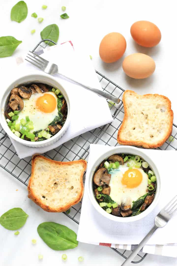 Baked eggs and spinach and mushrooms in ramekins.