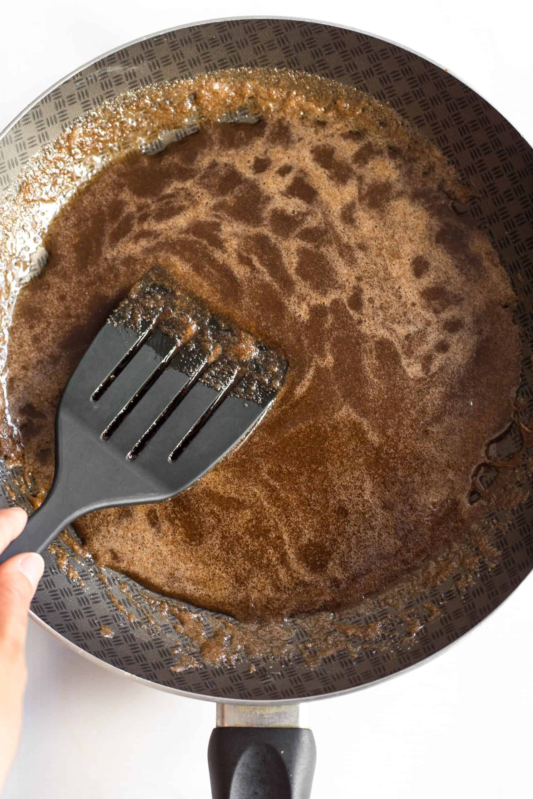 Mixing brown sugar mixture in a skillet.