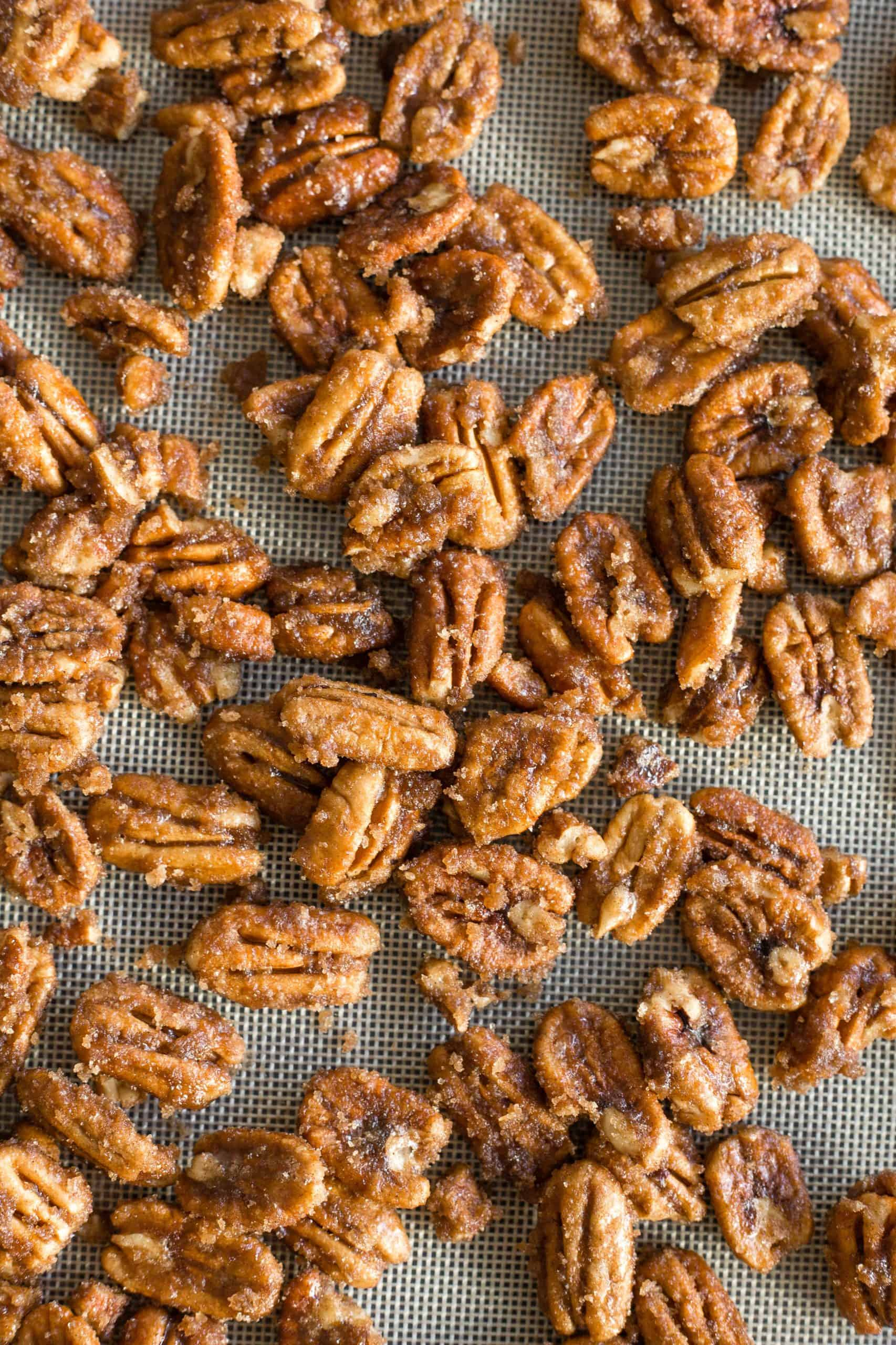 Candied pecans cooling on a silpat.