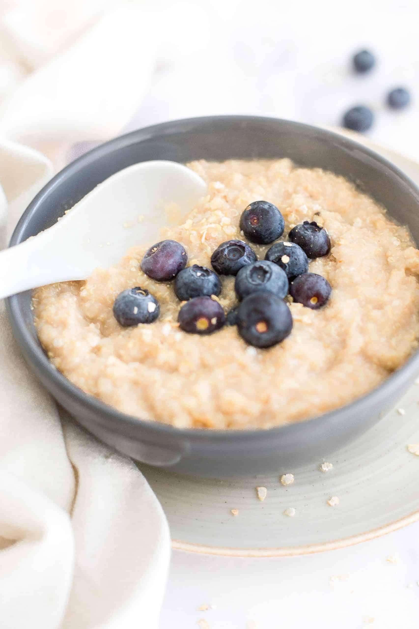 Up close shot of quinoa porridge in a gray bowl.