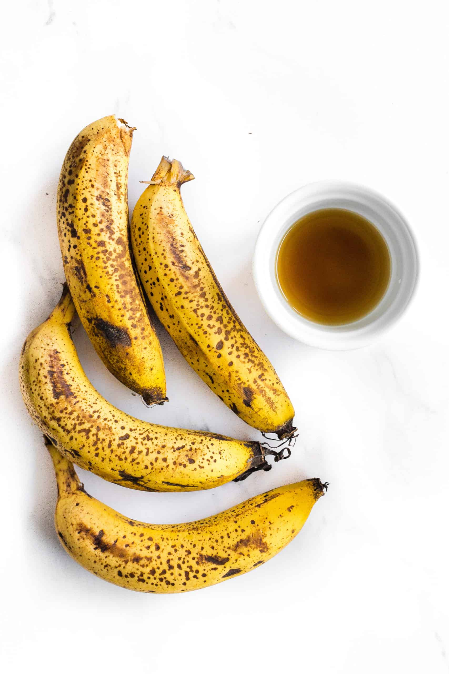 Bananas and vanilla extract on a marble board