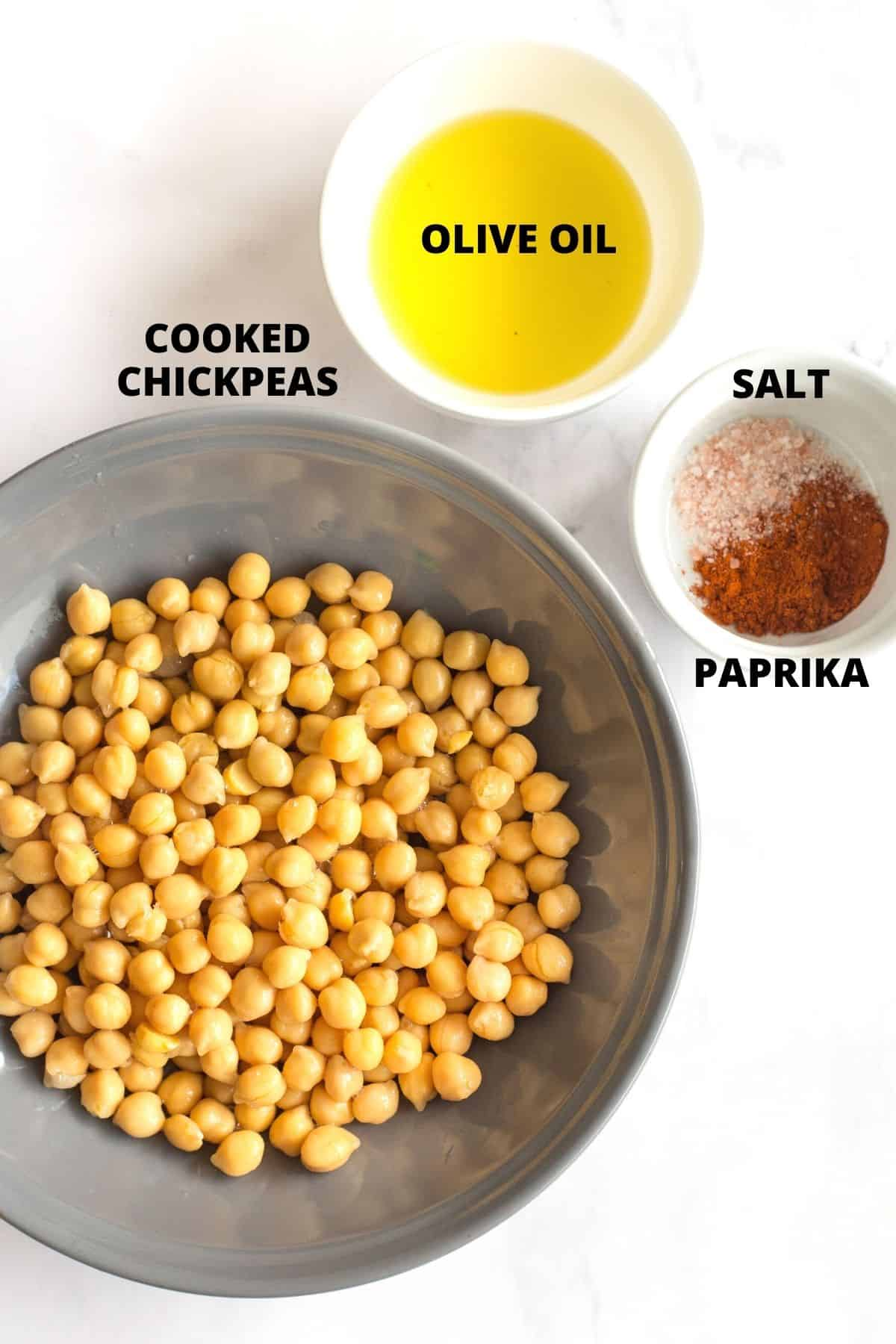 Labeled ingredients for air fryer chickpeas on a marble board.