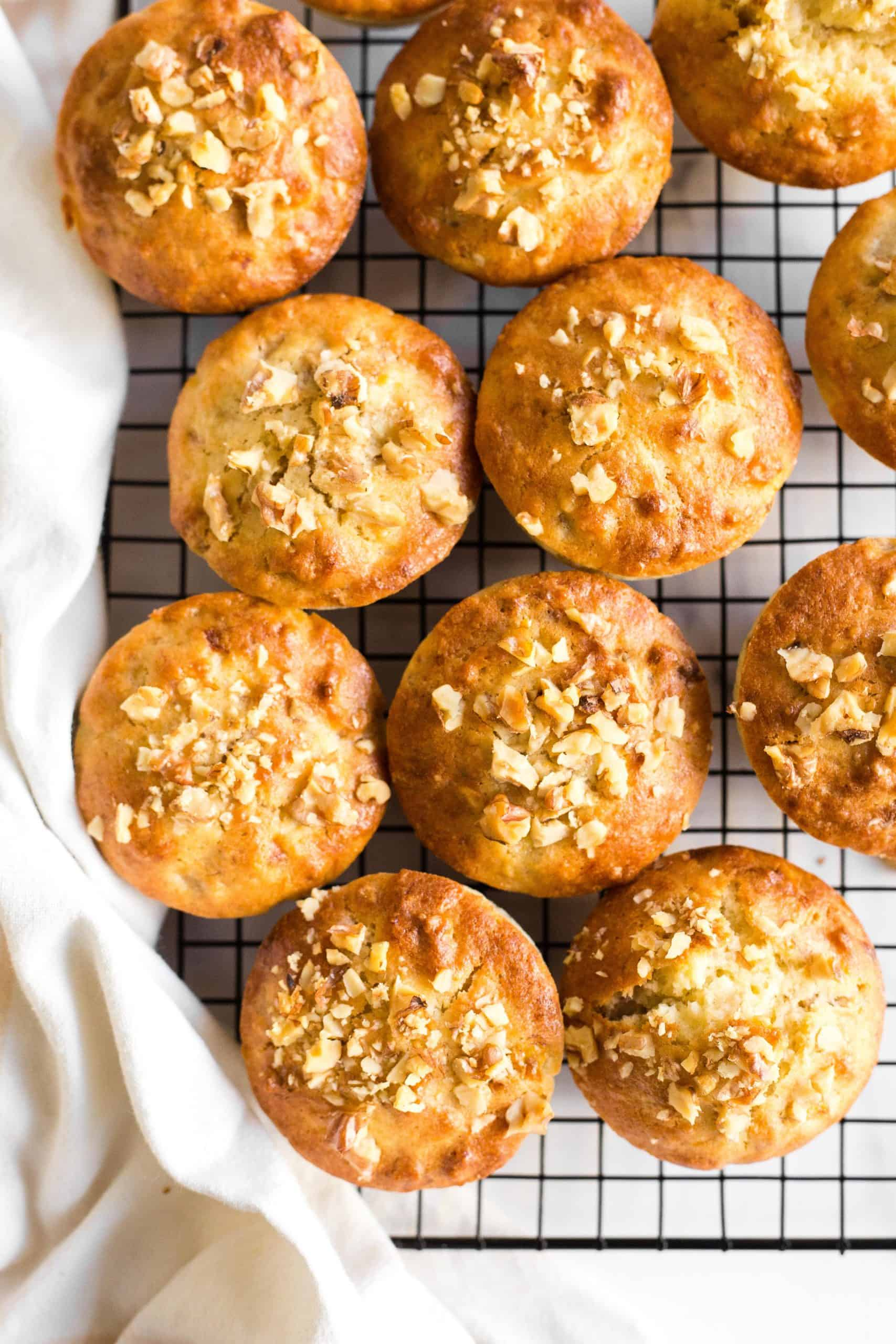 Banana nut muffins cooling on a wire rack.