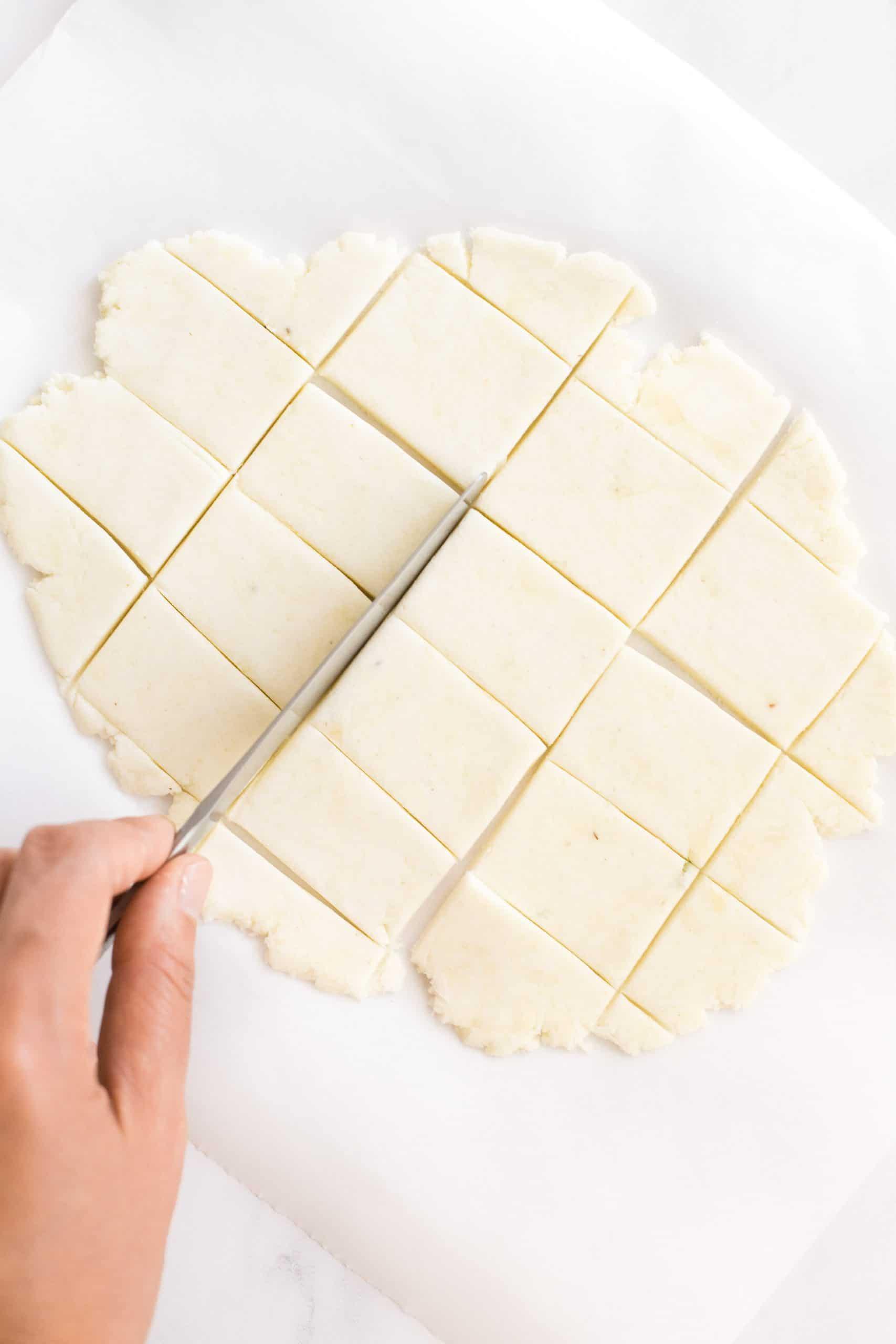 Cutting dough into squares.