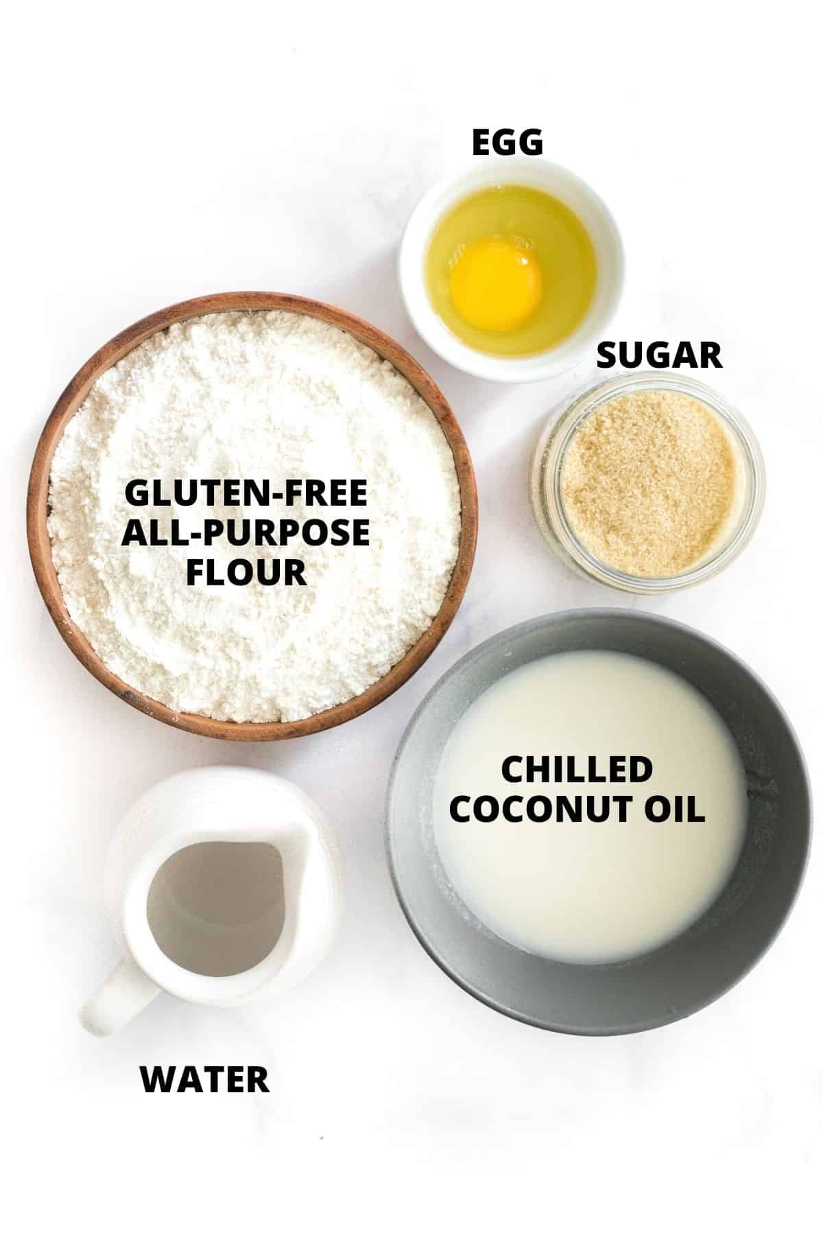 Labeled ingredients for gluten-free pie crust laid out on marble board.