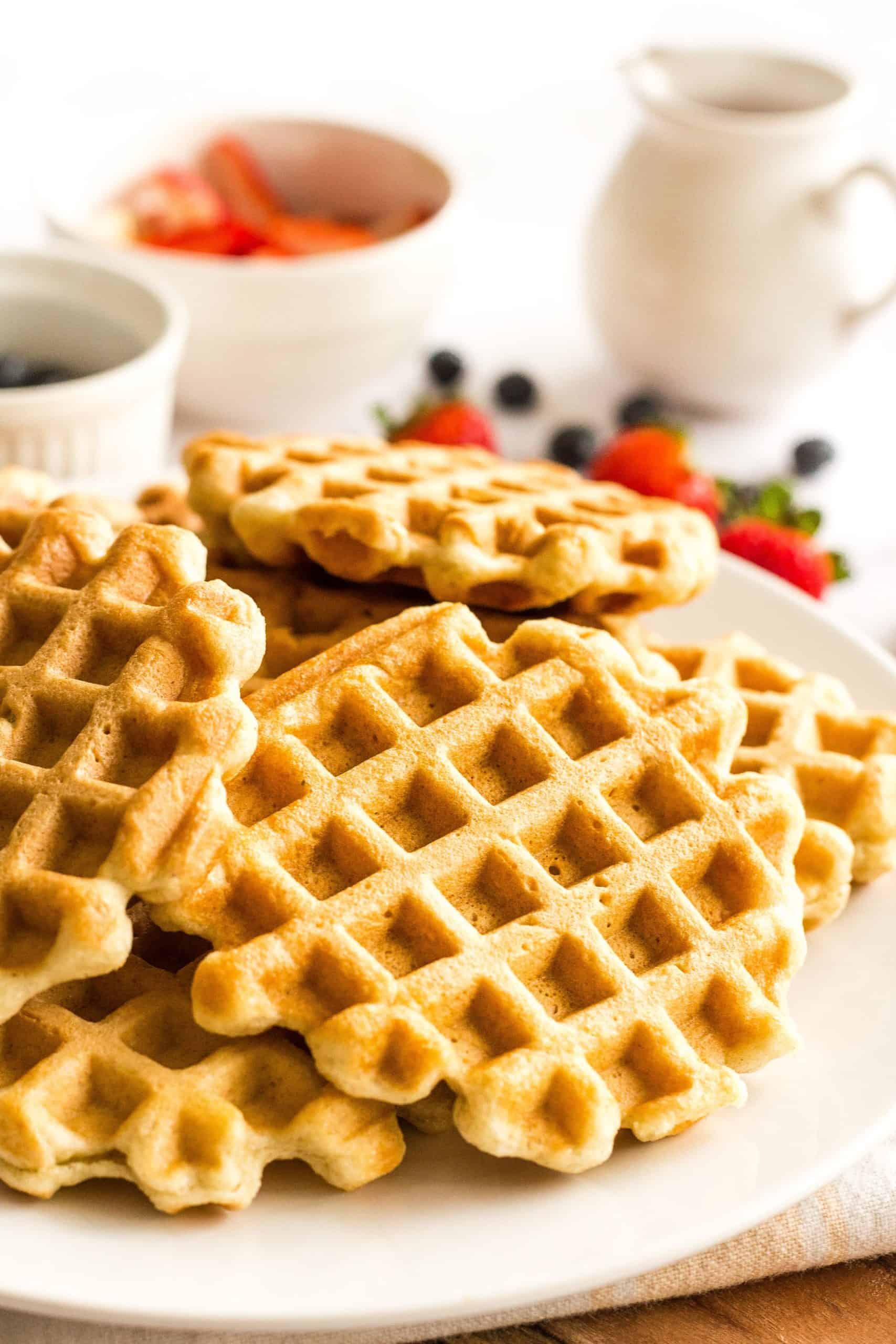 A plate full of freshly made gluten-free waffles.