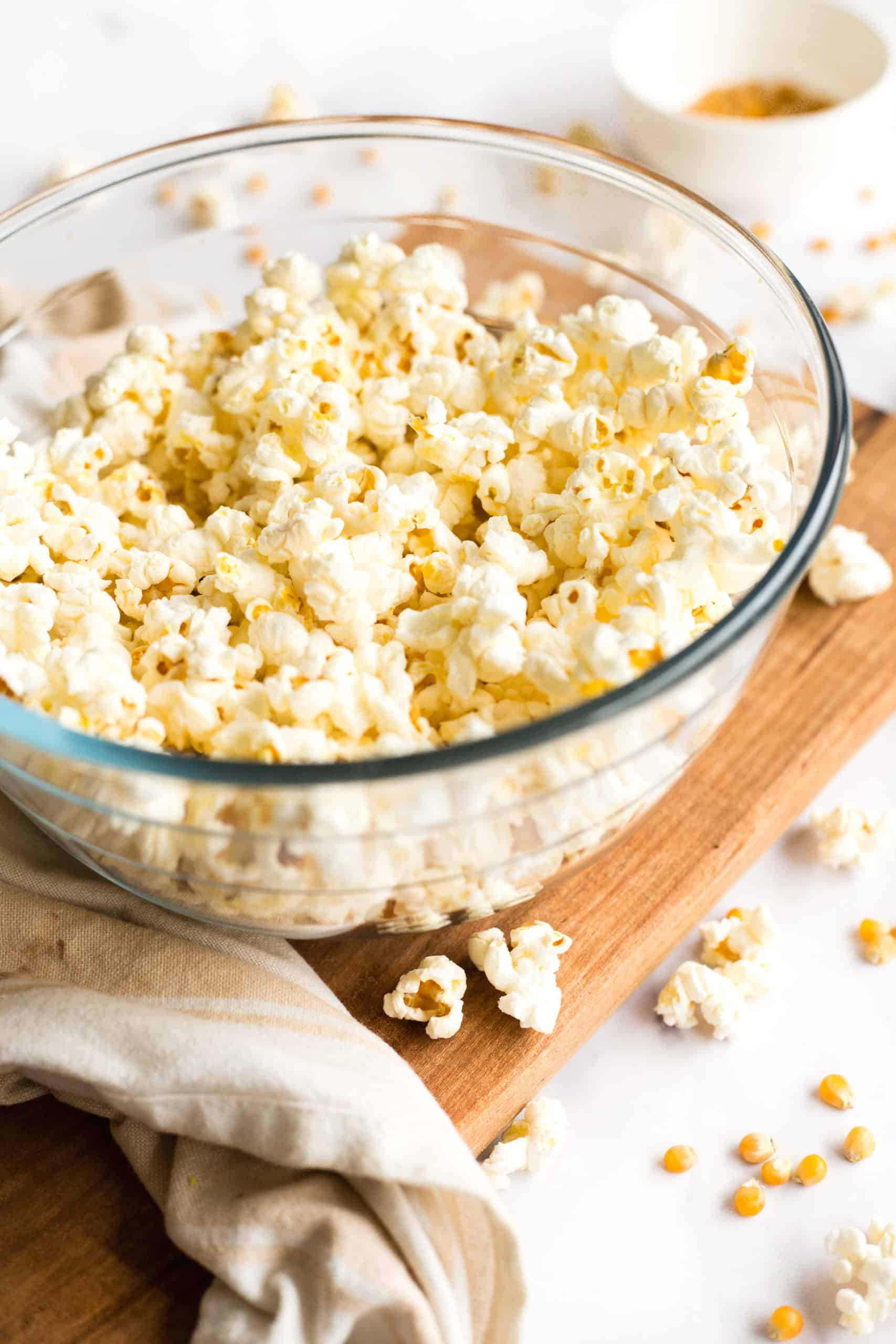 A bowl full of freshly popped microwave popcorn.