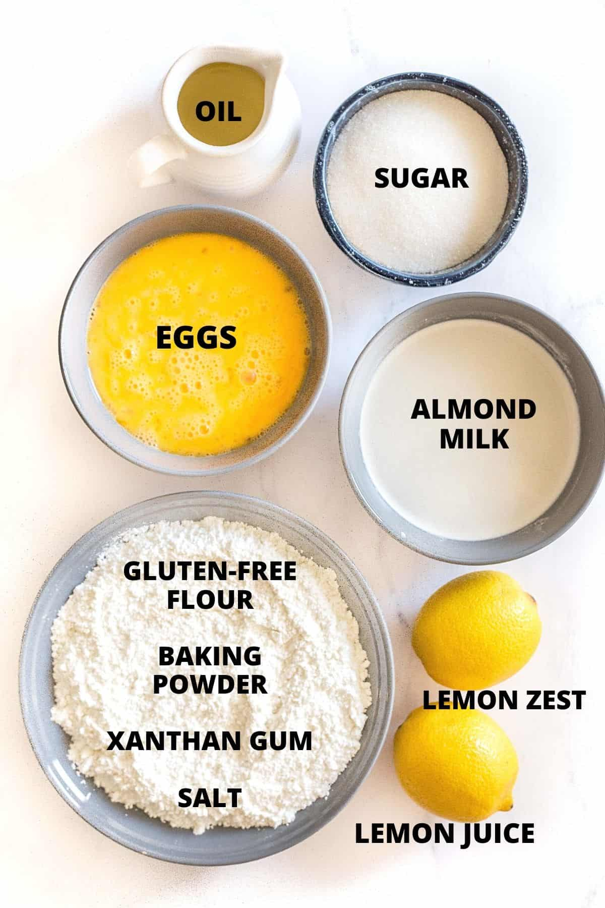 Ingredients for gluten-free lemon muffins laid out on a marble board.