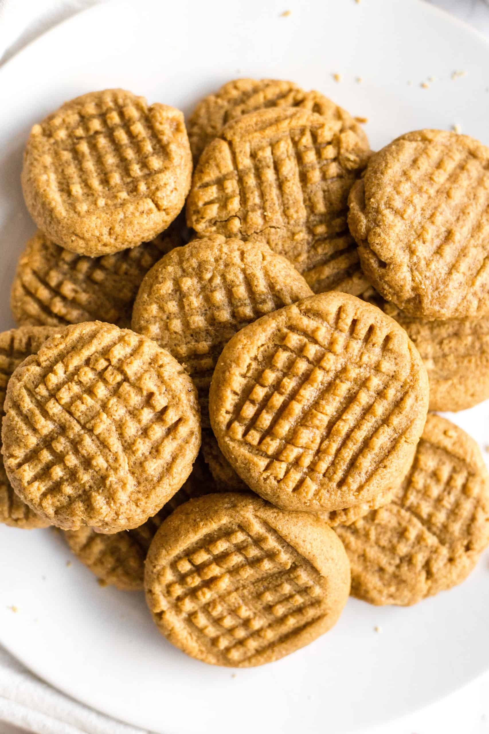 A plate full of flourless peanut butter cookies.