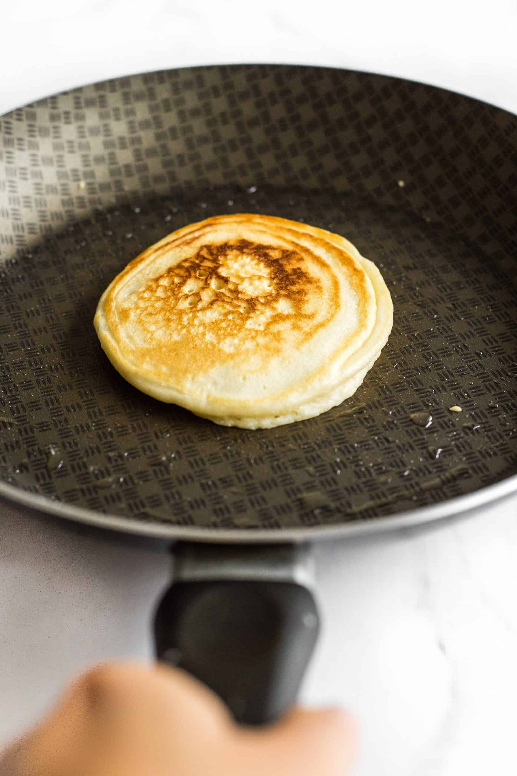 Cooking a pancake in a non-stick skillet.