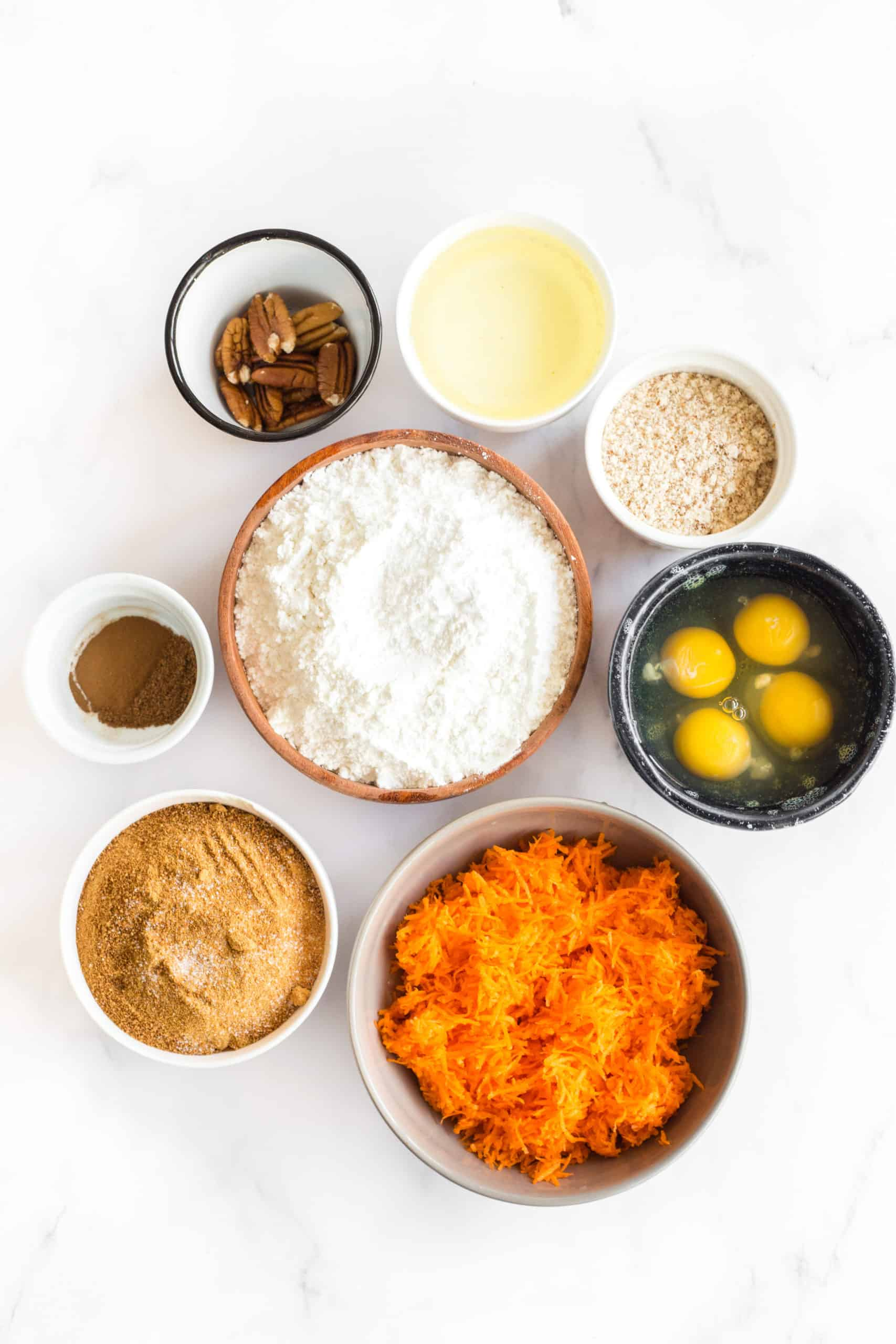 Ingredients for gluten-free carrot cake bread on a marble board