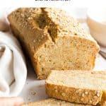 Hand holding a slice of quinoa bread