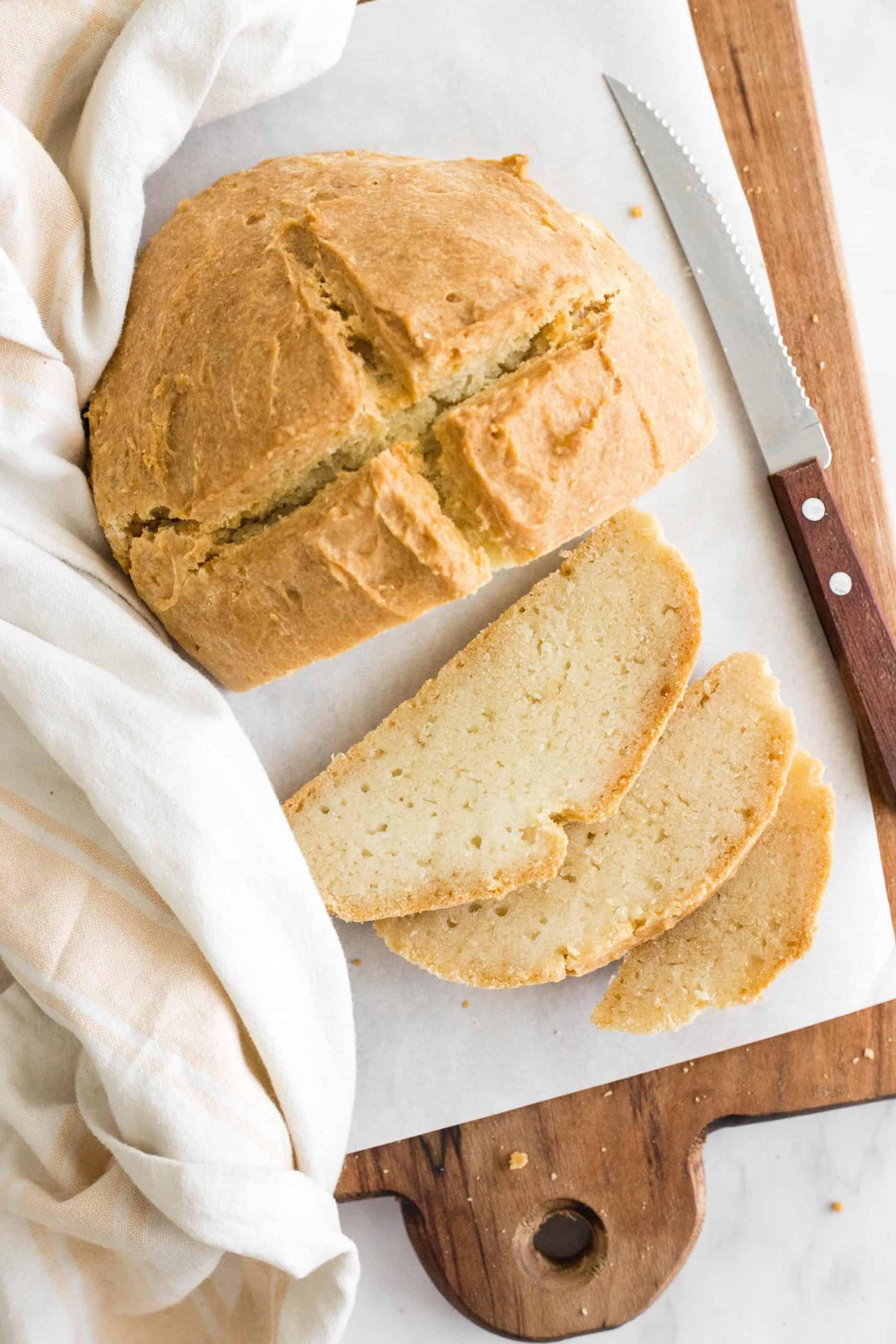 Sliced soda bread on a wooden board.