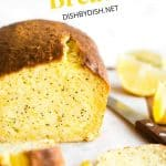 An up close shot of a sliced loaf of lemon poppy seed bread.