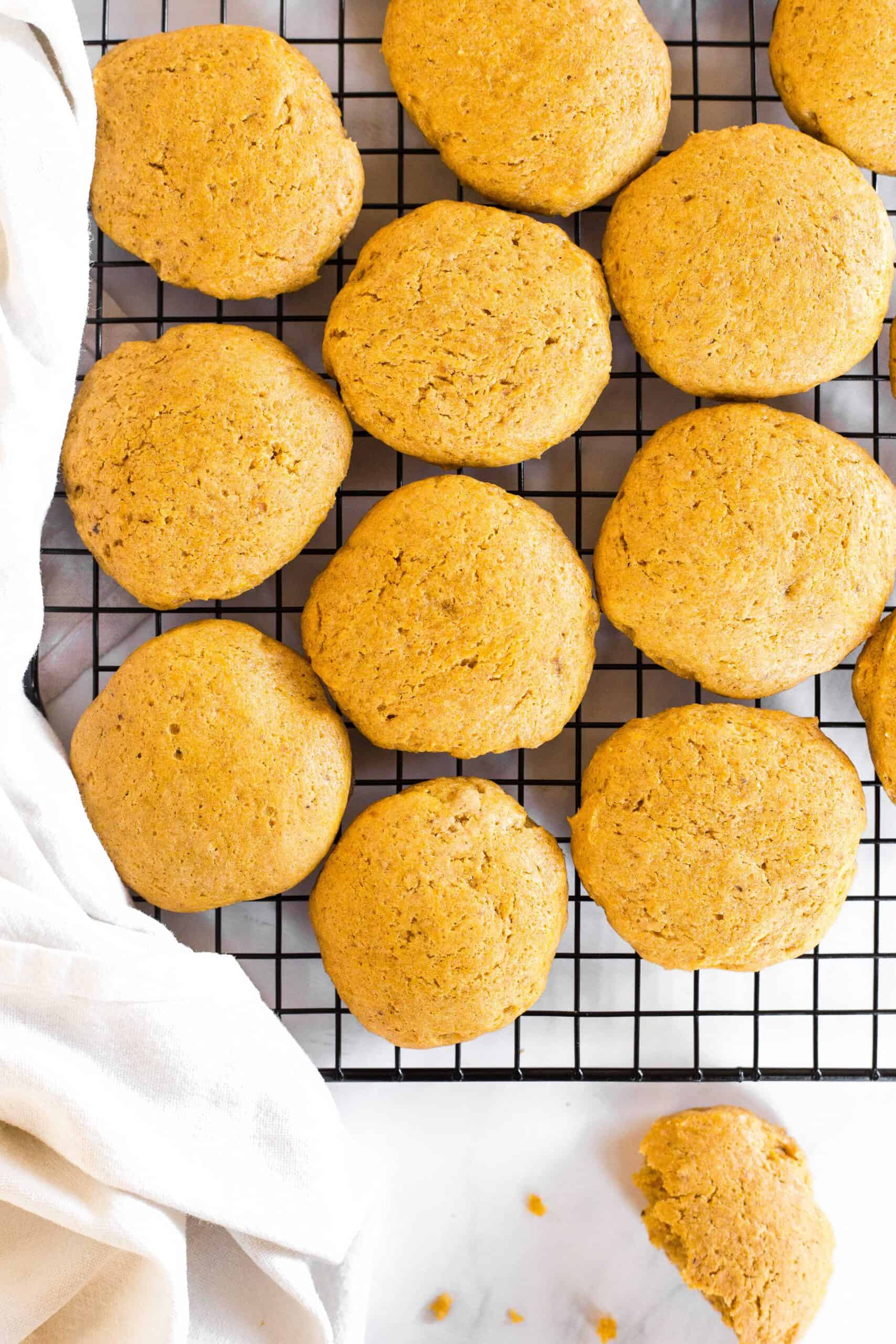 Soft pumpkin cookies cooling on a wire rack.