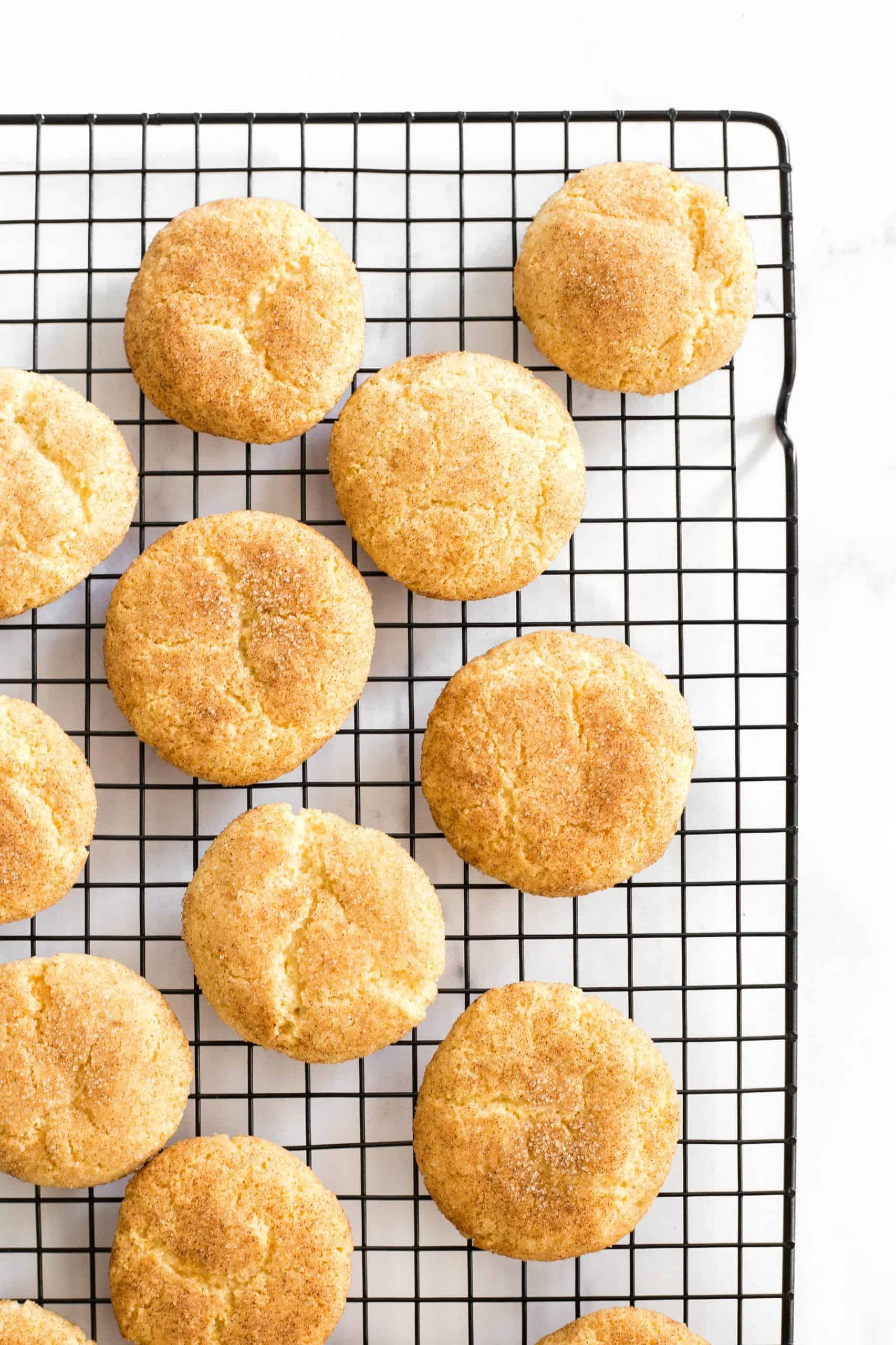 Snickerdoodles cooling on a wire rack.