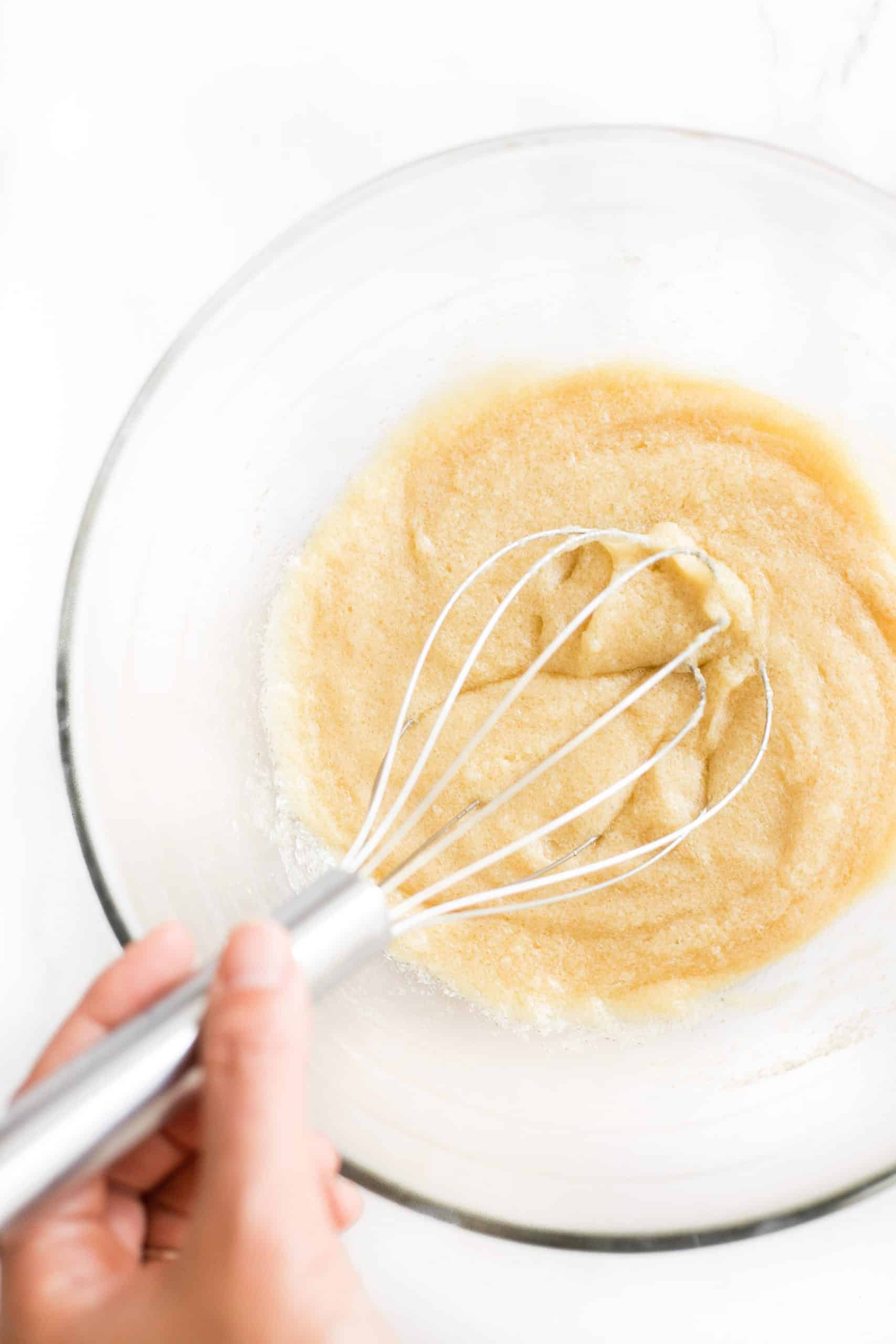 Whisking a batter in the bowl.