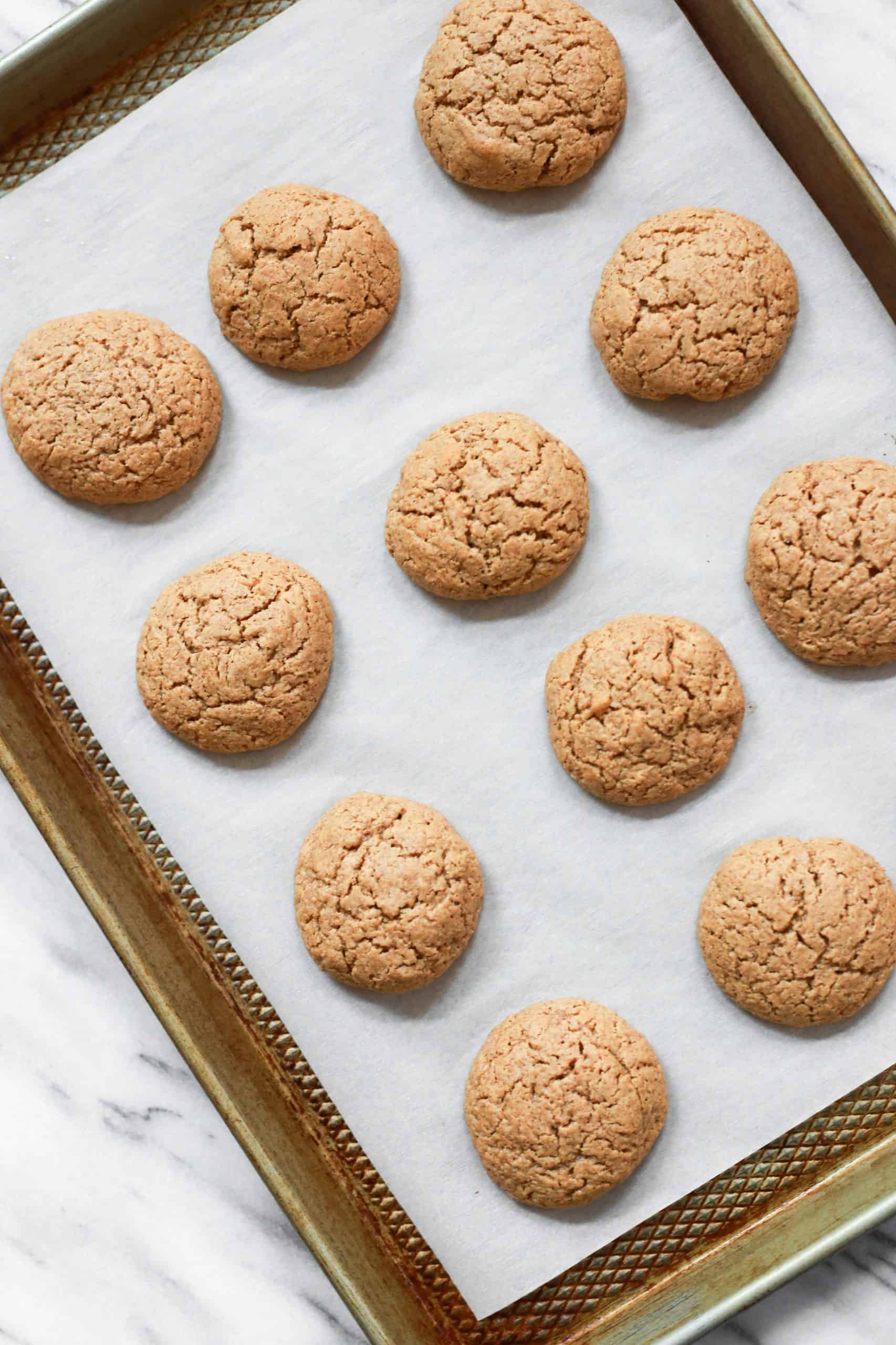 Almond butter cookies on a parchment-lined baking sheet.