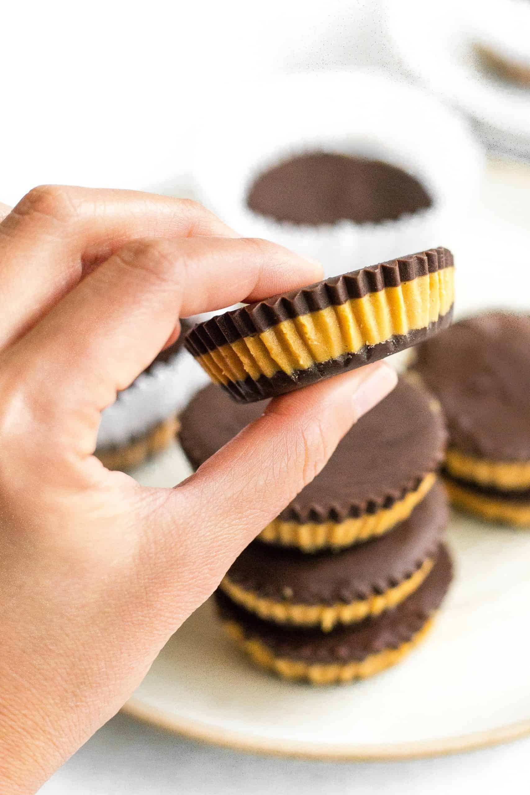 Hand holding a homemade peanut butter cup.
