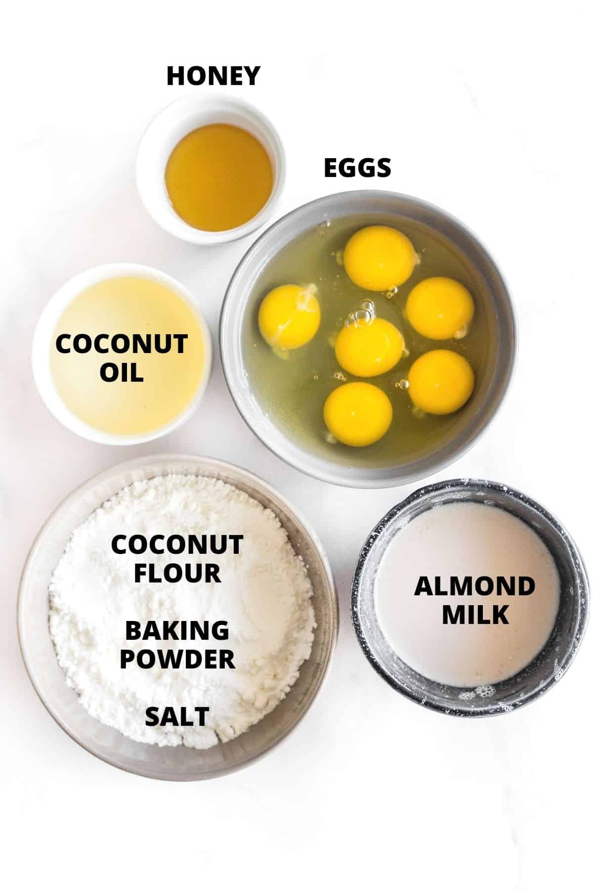 Ingredients for coconut flour bread laid out on a marble board.
