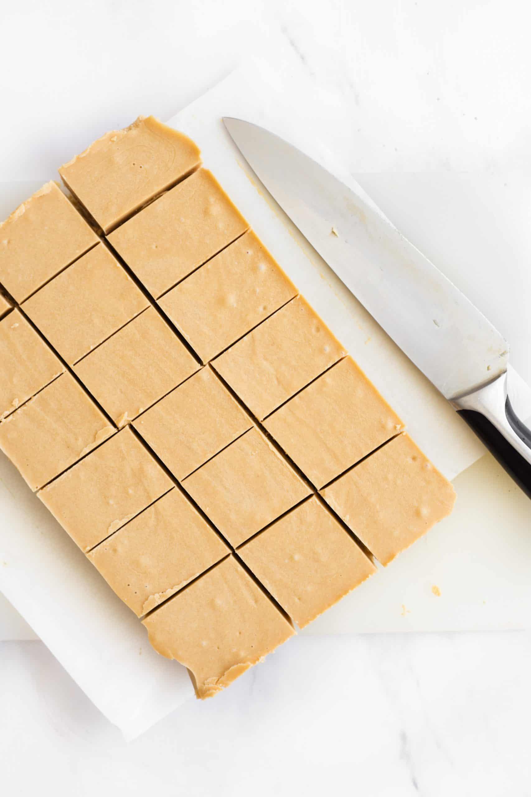 Cut pieces of fudge on parchment paper.
