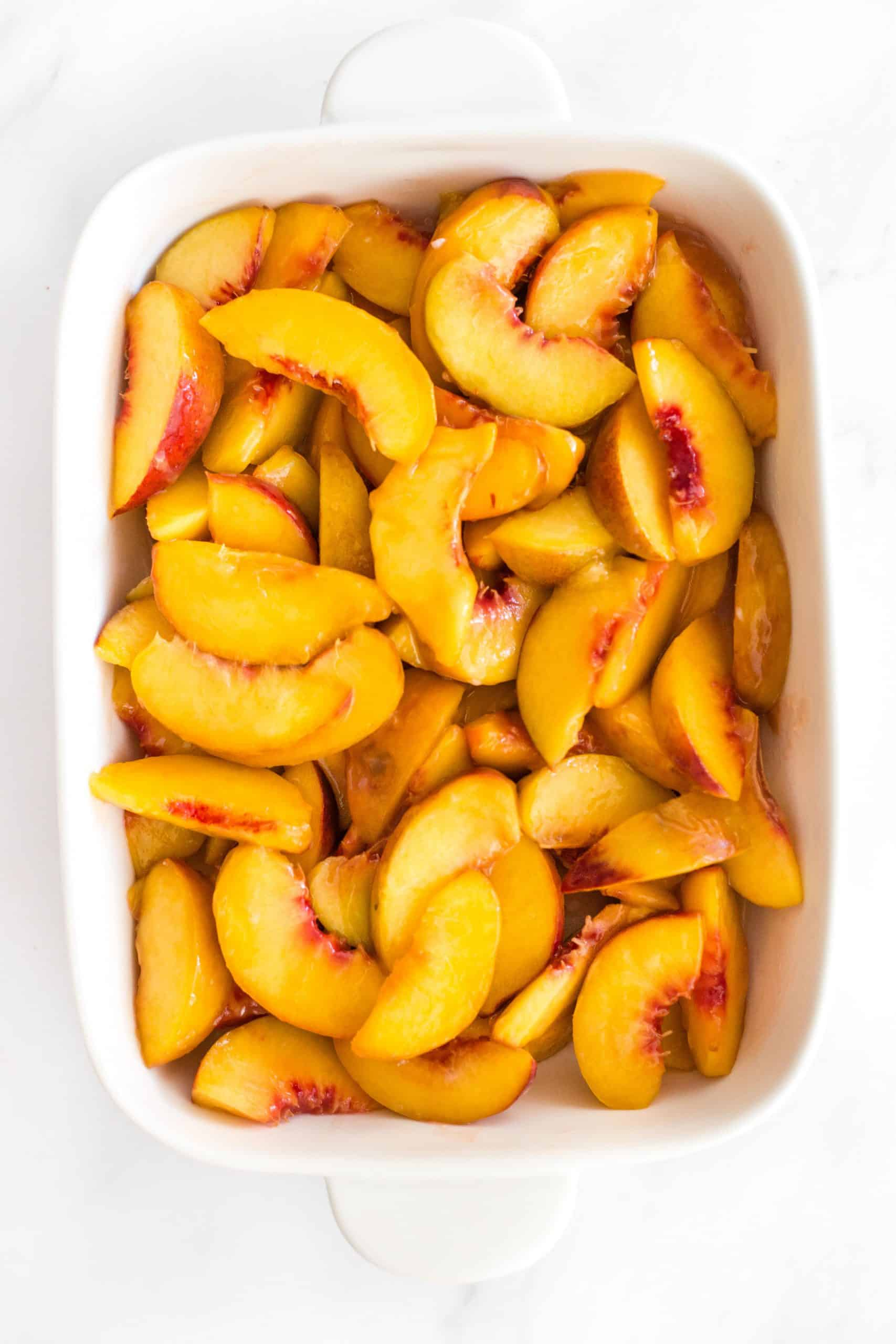 Peach slices in a baking dish.