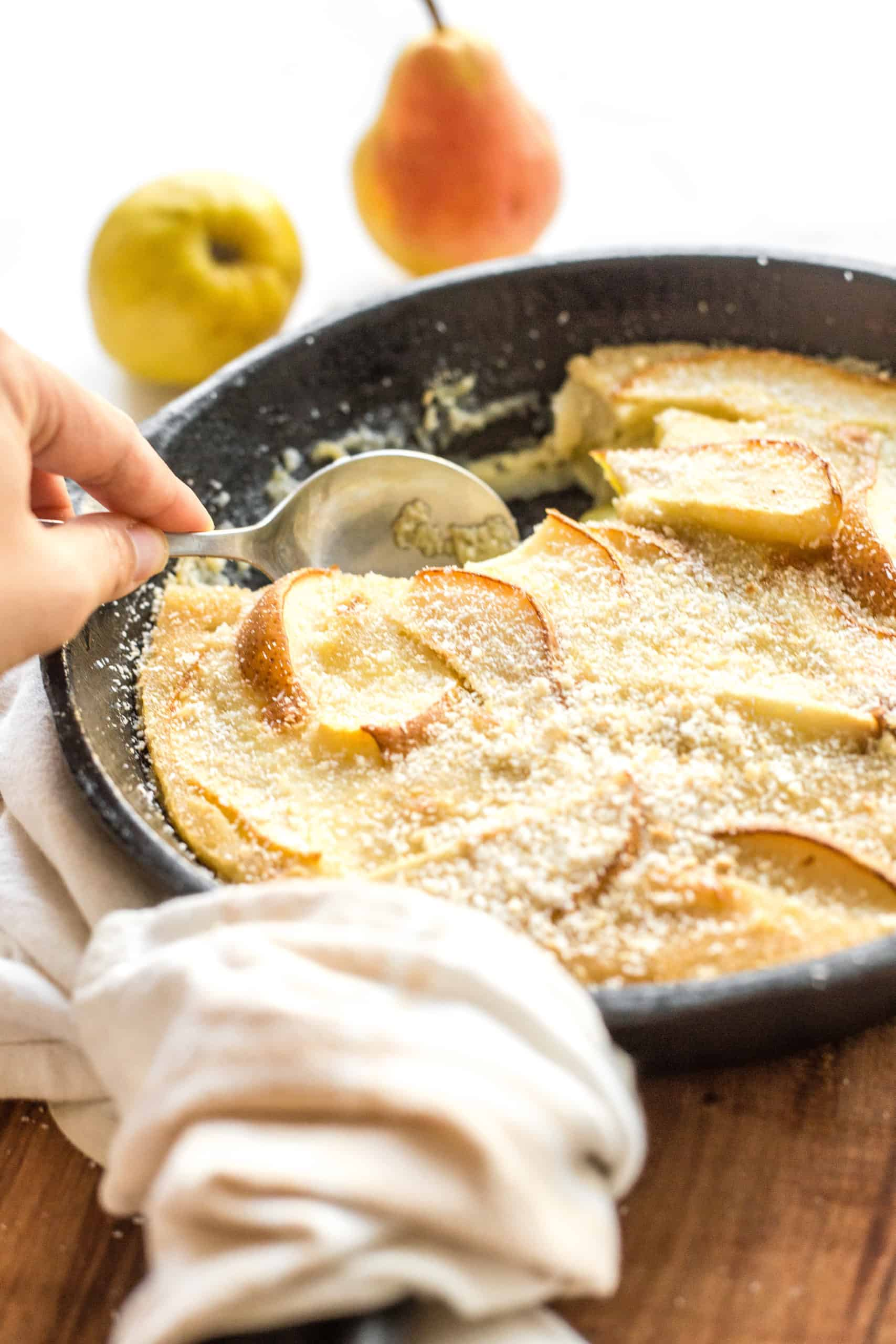 Scooping out Pear Custard Pie from Cast Iron Skillet