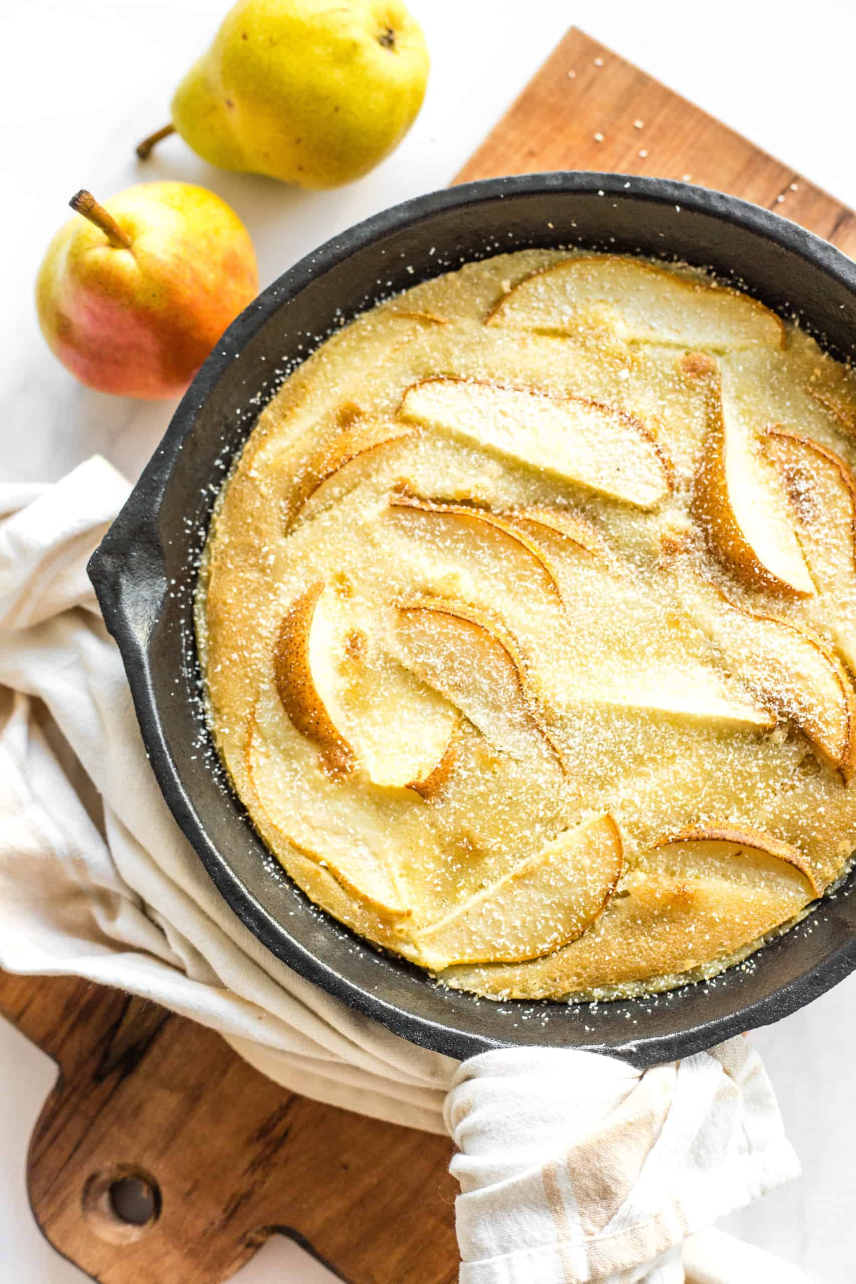 Pear custard pie in a cast iron skillet.