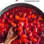 Stirring jam in a large skillet.