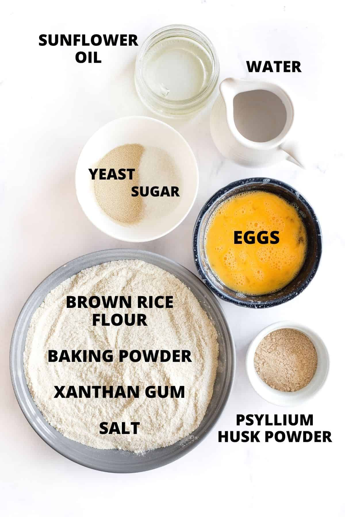 Ingredients required for making brown rice bread laid out on a marble board.