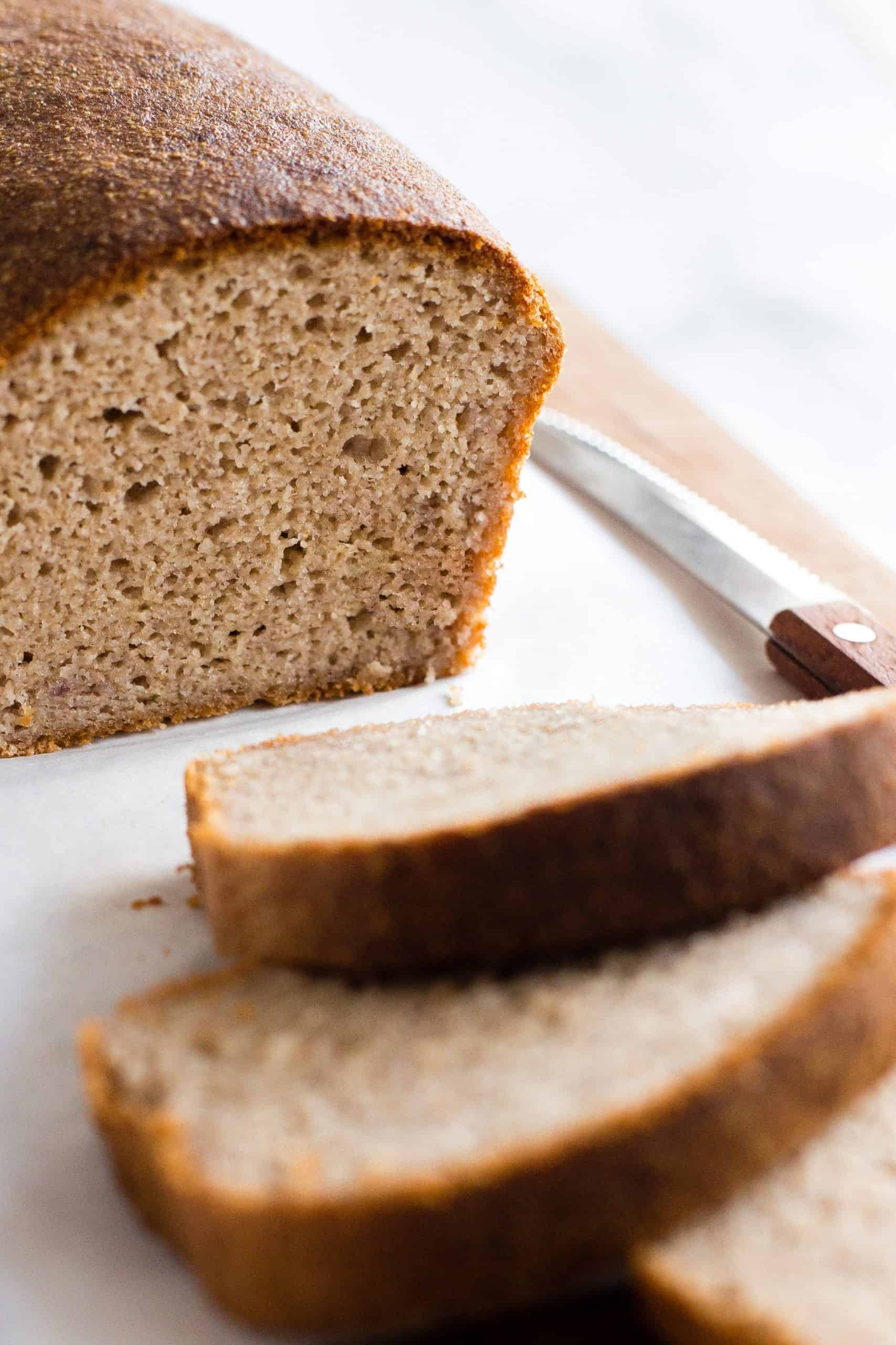 An up-close shot of the texture of the inside of a loaf of brown bread.
