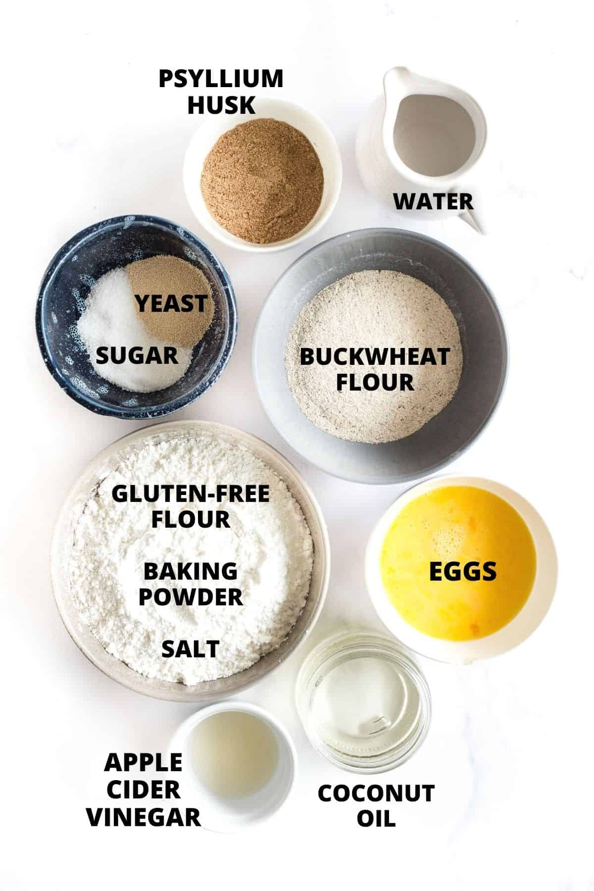 Ingredients for buckwheat bread laid out on a marble board.