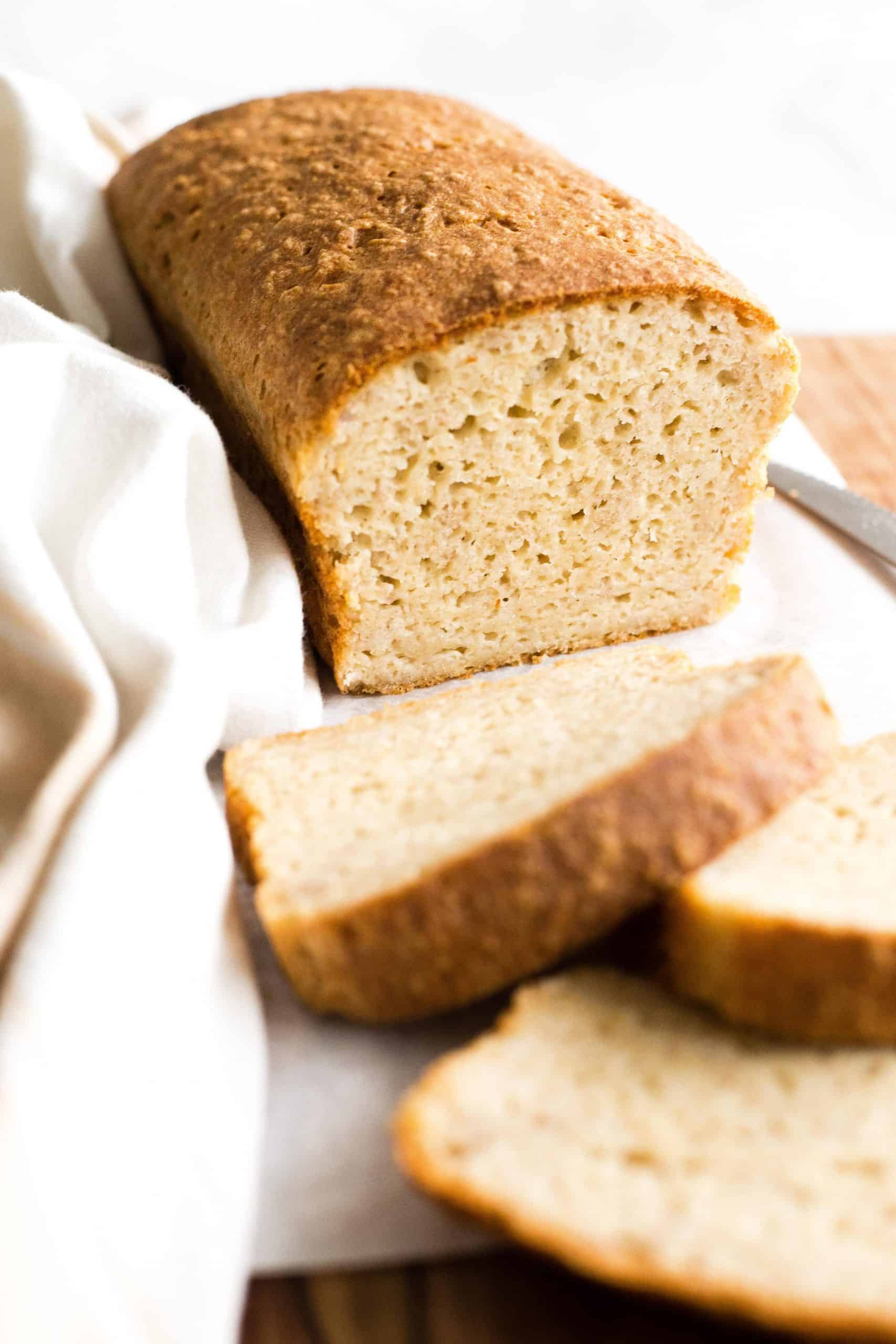 A half-sliced loaf of bread.