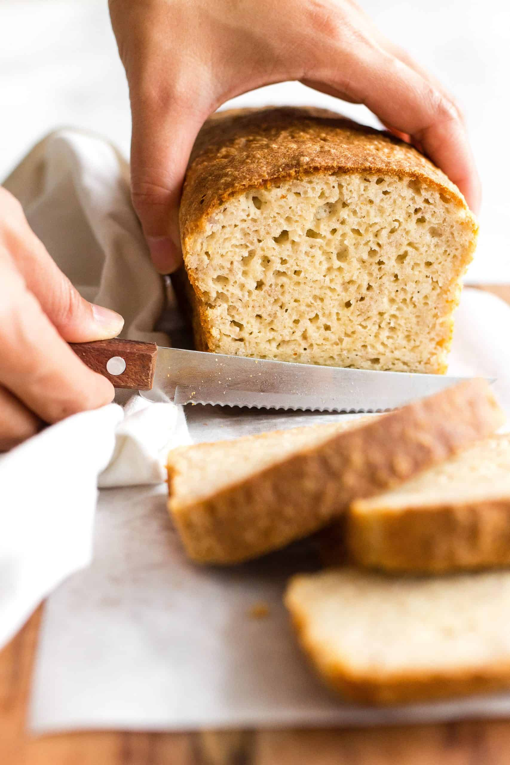 Slicing into a loaf of bread.