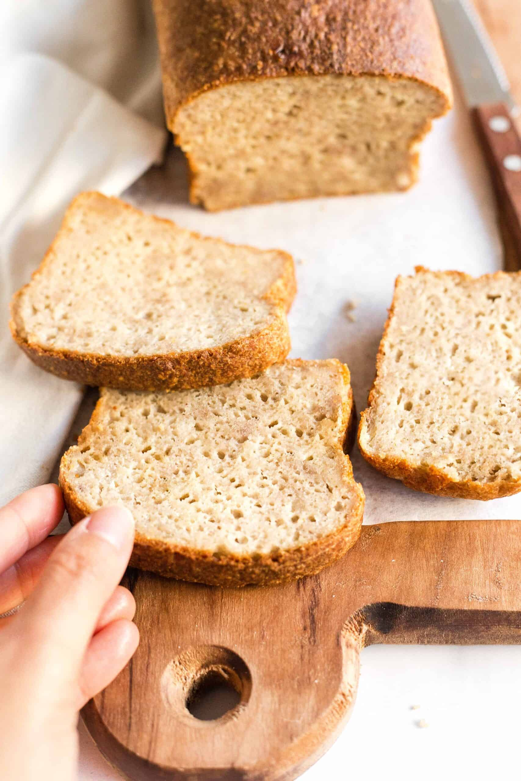 Reaching for a slice of yeast quinoa bread.