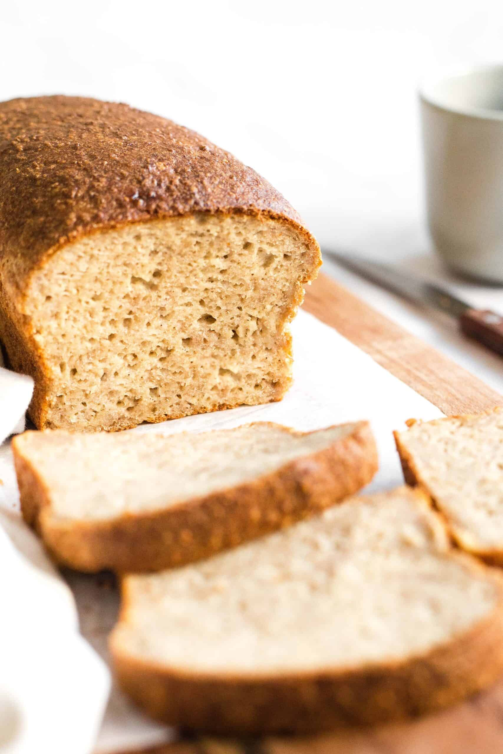 A half-sliced loaf of yeast quinoa bread.