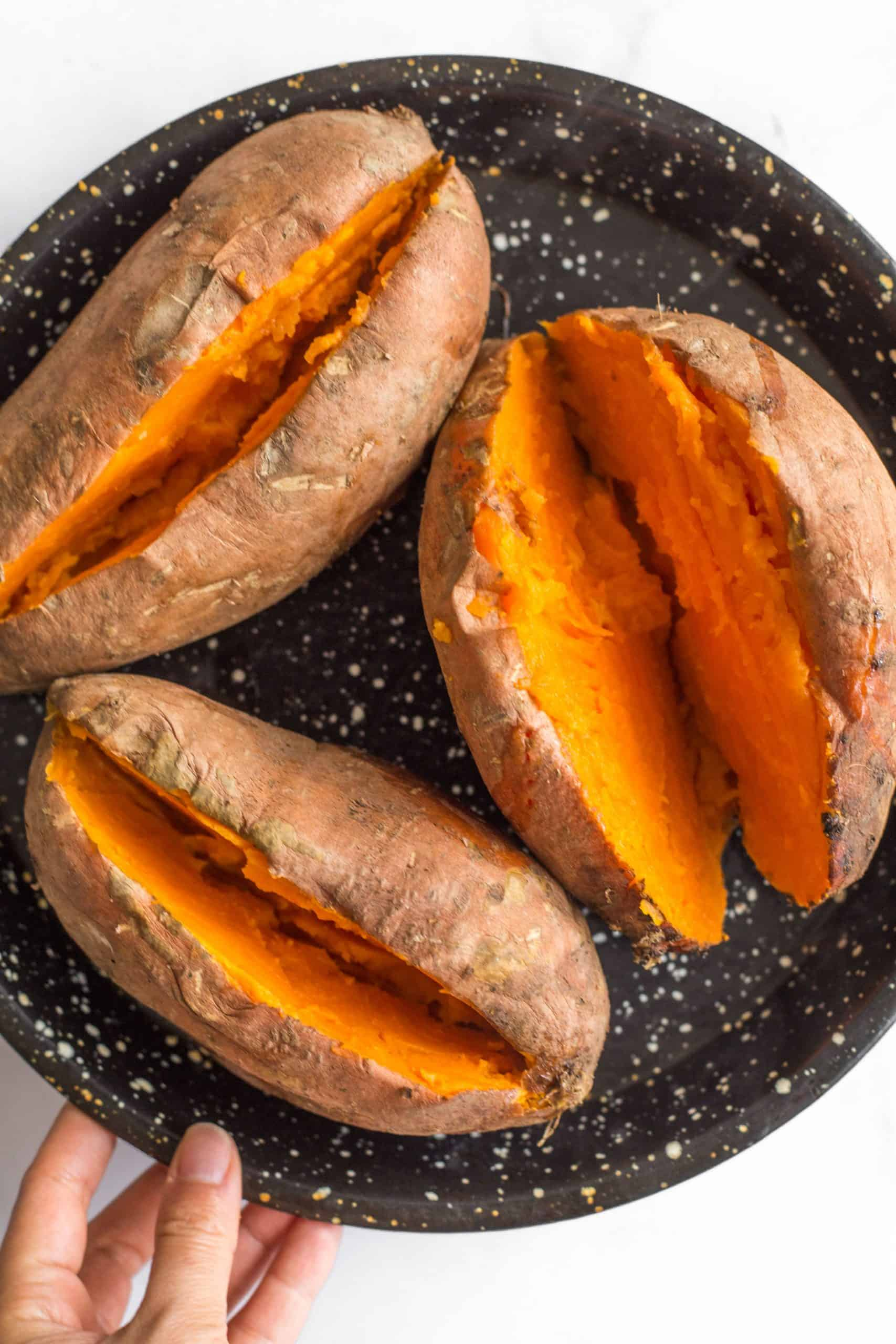 Baked sweet potatoes sliced into half lengthwise.