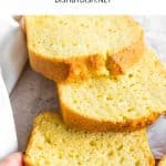 Hand reaching for a slice of corn flour bread.